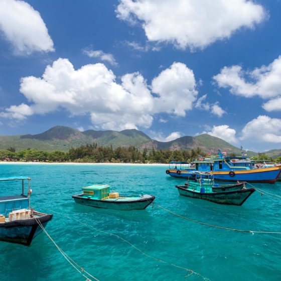 Vietnamese fishing boats on a tropical Con Dao Island.