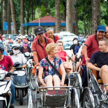Turists riding rickshaws in Ho Chi Minh city