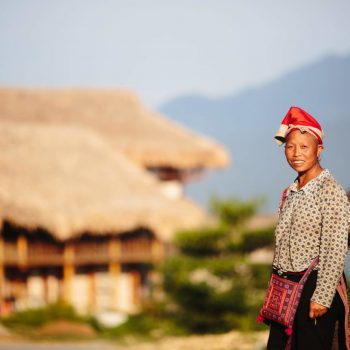 Local Red Dao minority woman welcoming guests at Topas Ecolodge entrance
