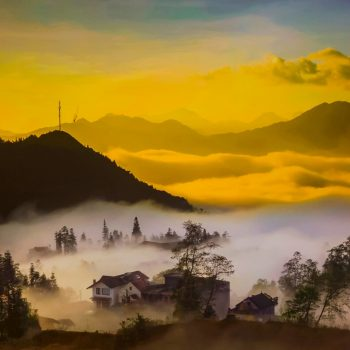 Panoramic view of suset in the misty Sapa mountains