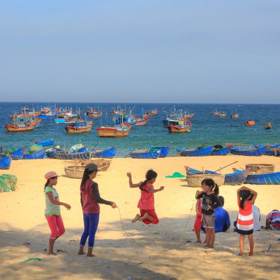 children play on the beach - Vietnam