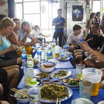 Tourists enjoying street food in Saigon