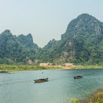 Beautiful Dong Hoi river with mountains in the background