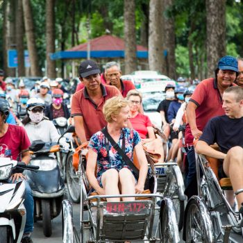 Turists riding rickshaws in Ho Chi Minh city