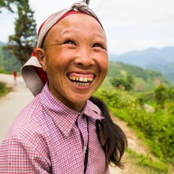 Red Dao villager smiling towards camera in Sapa
