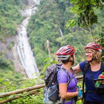 Happy turists on biking tour in Sapa