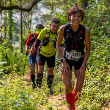 Exhausting and happy trail runner in Vietnam Mountain Marathon