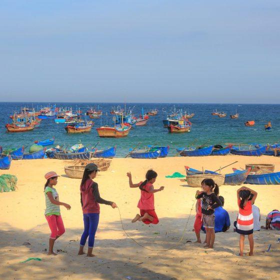 children play on the beach - Vietnam